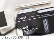Купить «Santa Clara, California, USA - 14 March 2019: AMD, graphics processor official website homepage under magnifying glass. Concept AMD, GPU, graphics processor logo visible on smartphone, tablet screen,», фото № 30299408, снято 24 февраля 2019 г. (c) Сергей Тимофеев / Фотобанк Лори