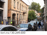 Купить «Old mansion with stucco decorations in the old town, Sololaki district, Pavle Ingorokva street, Tbilisi», фото № 30299600, снято 22 сентября 2018 г. (c) Юлия Бабкина / Фотобанк Лори