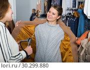 Купить «Woman trying new overcoat», фото № 30299880, снято 6 декабря 2018 г. (c) Яков Филимонов / Фотобанк Лори