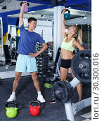 Купить «Couple during weightlifting workout», фото № 30300016, снято 16 июля 2018 г. (c) Яков Филимонов / Фотобанк Лори