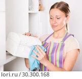 Купить «Woman wiping jewelry box», фото № 30300168, снято 12 апреля 2017 г. (c) Яков Филимонов / Фотобанк Лори