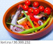 Купить «Fisherman's soup prepared with poutassou, small sea fish, cherry tomatoes», фото № 30300232, снято 23 августа 2018 г. (c) Яков Филимонов / Фотобанк Лори