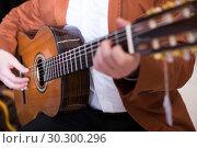 Купить «Male musician performing on guitar», фото № 30300296, снято 29 марта 2017 г. (c) Яков Филимонов / Фотобанк Лори