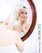 Купить «Woman after a shower near mirror», фото № 30306372, снято 23 марта 2019 г. (c) Яков Филимонов / Фотобанк Лори
