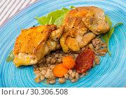 Купить «Chicken thighs with barley porridge», фото № 30306508, снято 2 июля 2018 г. (c) Яков Филимонов / Фотобанк Лори