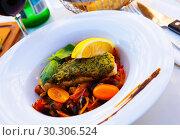 Купить «Red fish baked with vegetables», фото № 30306524, снято 10 октября 2018 г. (c) Яков Филимонов / Фотобанк Лори