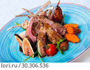 Купить «Plate of roasted mutton ribs», фото № 30306536, снято 22 мая 2019 г. (c) Яков Филимонов / Фотобанк Лори