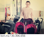 Купить «Positive female choosing carriage for twins in the children's store», фото № 30306656, снято 19 декабря 2017 г. (c) Яков Филимонов / Фотобанк Лори