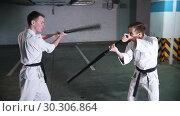 Купить «Two men training kendo on a parking lot. Sword fight», видеоролик № 30306864, снято 8 июля 2020 г. (c) Константин Шишкин / Фотобанк Лори