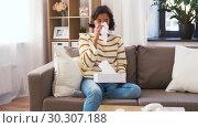 Купить «sick woman blowing nose in paper tissue at home», видеоролик № 30307188, снято 10 марта 2019 г. (c) Syda Productions / Фотобанк Лори