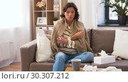 Купить «ill woman measuring temperature by thermometer», видеоролик № 30307212, снято 10 марта 2019 г. (c) Syda Productions / Фотобанк Лори
