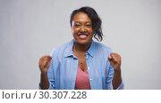 Купить «happy african american woman celebrating success», видеоролик № 30307228, снято 10 марта 2019 г. (c) Syda Productions / Фотобанк Лори