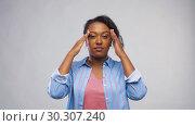 Купить «african american woman suffering from headache», видеоролик № 30307240, снято 10 марта 2019 г. (c) Syda Productions / Фотобанк Лори