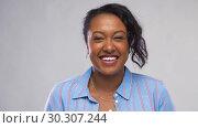 Купить «happy african american woman over grey background», видеоролик № 30307244, снято 10 марта 2019 г. (c) Syda Productions / Фотобанк Лори