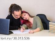 Купить «Девушка устало прилегла на плечо молодого человека за столом в офисе», фото № 30313536, снято 14 марта 2019 г. (c) Гетманец Инна / Фотобанк Лори