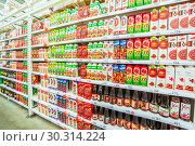 Купить «Russia Samara March 2019: A large selection of fruit juices in the supermarket. Text in Russian: kind, pomegranate, discount, darling, My family, orchard», фото № 30314224, снято 1 марта 2019 г. (c) Акиньшин Владимир / Фотобанк Лори