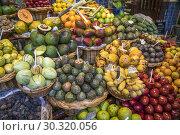 Купить «Fruits stall at the market hall Mercado dos Lavradores, Funchal, Madeira, Portugal, Europe.», фото № 30320056, снято 15 февраля 2019 г. (c) age Fotostock / Фотобанк Лори