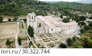 Купить «Aerial view of Castle of Abbey Sainte-Marie d'Orbieu in Lagrasse, France», видеоролик № 30322744, снято 26 октября 2018 г. (c) Яков Филимонов / Фотобанк Лори