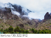 Купить «Fabulous Masca mountain gorge the most visited tourist attraction on Tenerife», фото № 30322912, снято 13 сентября 2015 г. (c) Ирина Мойсеева / Фотобанк Лори