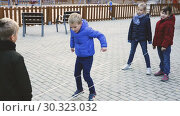 Купить «Happy kids skipping on chinese jump rope on playground in autumn day», видеоролик № 30323032, снято 18 декабря 2018 г. (c) Яков Филимонов / Фотобанк Лори