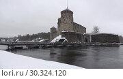 Купить «Вид на крепость Олавинлинна сумрачным мартовским днем. Савонлинна, Финляндия», видеоролик № 30324120, снято 16 марта 2019 г. (c) Виктор Карасев / Фотобанк Лори