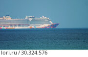 Купить «Genting Dream cruise ship near Phuket», видеоролик № 30324576, снято 27 ноября 2018 г. (c) Игорь Жоров / Фотобанк Лори