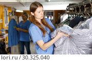 Купить «Two women working at dry-cleaning salon», фото № 30325040, снято 22 января 2019 г. (c) Яков Филимонов / Фотобанк Лори