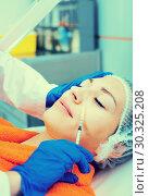 Купить «Female doctor doing beauty injection to young woman client», фото № 30325208, снято 23 марта 2019 г. (c) Яков Филимонов / Фотобанк Лори