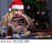Купить «Girl in a plaid is ill of virus in the New Year night», фото № 30325280, снято 6 января 2018 г. (c) Яков Филимонов / Фотобанк Лори