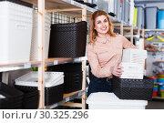 Купить «Girl choosing boxes storage», фото № 30325296, снято 15 января 2018 г. (c) Яков Филимонов / Фотобанк Лори