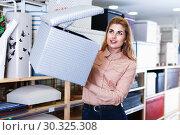 Купить «Young woman choosing soft pouf in modern home furnishings store», фото № 30325308, снято 15 января 2018 г. (c) Яков Филимонов / Фотобанк Лори