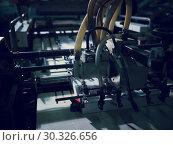 Купить «Large Industrial Printer In A Print Shop», фото № 30326656, снято 22 января 2019 г. (c) Pavel Biryukov / Фотобанк Лори