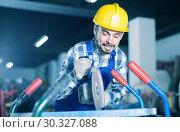 working man practicing his skills with angle grinder at workshop. Стоковое фото, фотограф Яков Филимонов / Фотобанк Лори