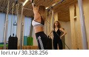 Купить «Young women doing fitness in the gym. A woman doing strength exercises on the hands», видеоролик № 30328256, снято 25 марта 2019 г. (c) Константин Шишкин / Фотобанк Лори