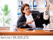 Купить «Middle-aged female doctor working in courthouse», фото № 30329272, снято 4 декабря 2018 г. (c) Elnur / Фотобанк Лори