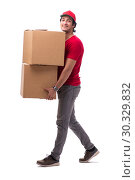 Купить «Young male courier with box», фото № 30329832, снято 9 ноября 2018 г. (c) Elnur / Фотобанк Лори
