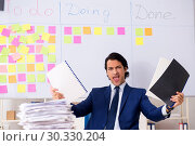 Купить «Young handsome employee in front of whiteboard with to-do list», фото № 30330204, снято 16 октября 2018 г. (c) Elnur / Фотобанк Лори