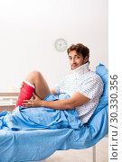 Купить «Injured man waiting treatment in the hospital», фото № 30330356, снято 22 сентября 2018 г. (c) Elnur / Фотобанк Лори