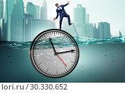 Купить «Businessman in deadline and time management concept», фото № 30330652, снято 19 марта 2019 г. (c) Elnur / Фотобанк Лори