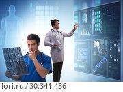 Купить «Doctor in telemedicine concept looking at x-ray image», фото № 30341436, снято 21 марта 2019 г. (c) Elnur / Фотобанк Лори