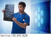 Купить «Doctor in telemedicine concept looking at x-ray image», фото № 30341828, снято 21 марта 2019 г. (c) Elnur / Фотобанк Лори