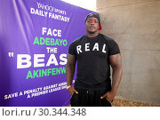 Купить «Adebayo 'The Beast' Akinfenwa was appearing at the Yahoo Sport Daily Fantasy Deadline Day Dugout event at Boxpark, Shoreditch. Featuring: Adebayo Akinfenwa...», фото № 30344348, снято 31 августа 2017 г. (c) age Fotostock / Фотобанк Лори