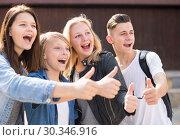 Купить «teenagers show their thumbs up», фото № 30346916, снято 15 сентября 2019 г. (c) Татьяна Яцевич / Фотобанк Лори