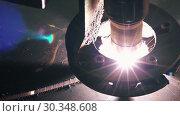 Купить «Close-up Top View Of A Laser Cutting Machine Head Cuts A Sheet», видеоролик № 30348608, снято 4 апреля 2020 г. (c) Pavel Biryukov / Фотобанк Лори