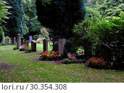 Купить «Ohlsdorf Cemetery in Hamburg, Germany, is the largest rural cemetery in the world, with an area of 391 hectares. It is not only used as a cemetery, but...», фото № 30354308, снято 26 августа 2017 г. (c) age Fotostock / Фотобанк Лори