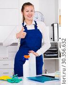 Купить «Housekeeper is satisfied after cleaning», фото № 30356632, снято 22 апреля 2019 г. (c) Яков Филимонов / Фотобанк Лори