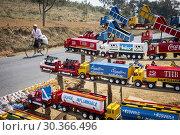 Купить «Selling wooden toys on National Highway 7, near Antananarivo, Madagascar.», фото № 30366496, снято 24 июня 2019 г. (c) age Fotostock / Фотобанк Лори