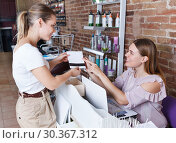 Купить «Administrator talking with client about services in nail salon», фото № 30367312, снято 30 мая 2018 г. (c) Яков Филимонов / Фотобанк Лори
