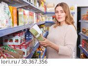 Купить «Female customer with assortment of grocery food store», фото № 30367356, снято 11 апреля 2018 г. (c) Яков Филимонов / Фотобанк Лори
