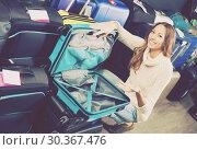 Woman selecting handy trunk. Стоковое фото, фотограф Яков Филимонов / Фотобанк Лори